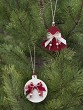 Traditional christmas hand made decoration hanging on fir tree.