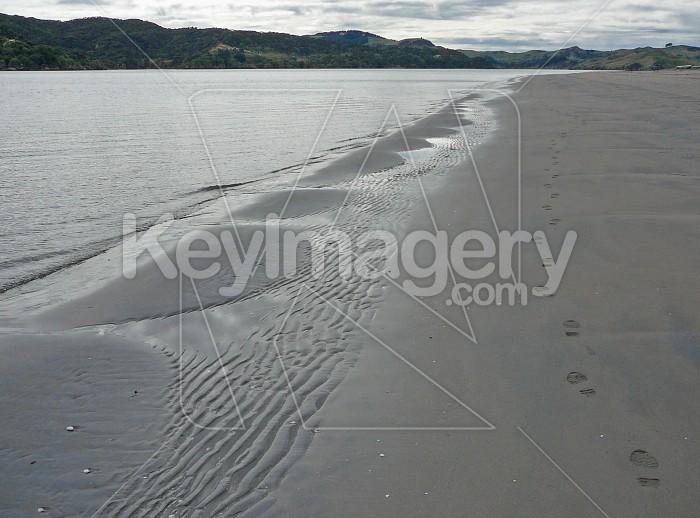 Footprints in the sand alongside sandmounds Photo #1300