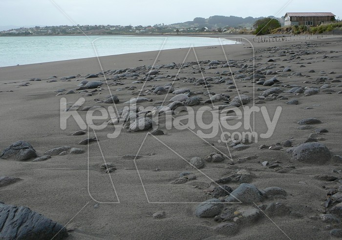 Rocks on black sand shore Photo #863