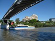The City Cat river boat going under the Goodwill Bridge