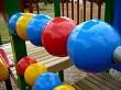 Coloured balls on a rail