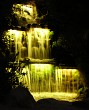 Waterfall at night, yellow lights