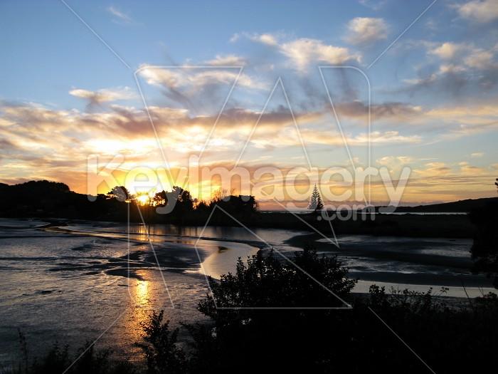 Sun setting over tidal stream 2 Photo #12051