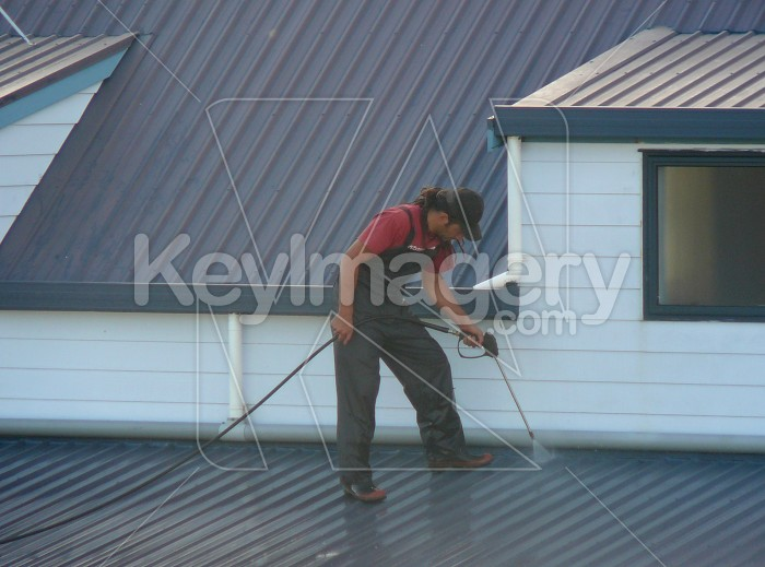 Water blasting a roof Photo #960